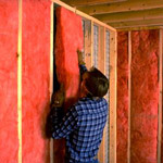 Installing Insulation Between Studs